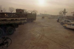 Kabul, Afghanistan -- Trucks wait in line at the warehouse prior to WFP food distribution at the old Soviet compund in Kabul. 12/20/01 (Photo by Bikem Ekberzade)