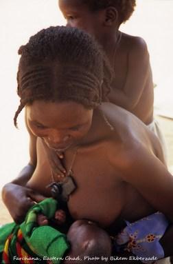 Farchana, Eastern Chad -- Havva Yahya Ismail beastfeeds her newborn. Photo by Bikem Ekberzade