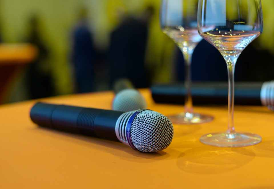 photo of wireless microphones on top of the table