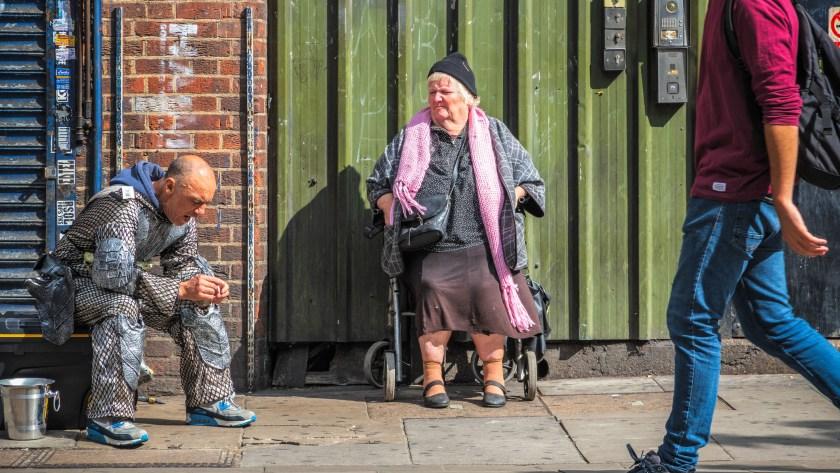 A woman in a wheelchair around Camden street market