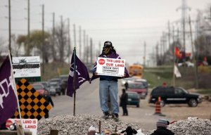 Caledonia, Ontario: April 21, 2006 Land defenders stand at a road blockade.