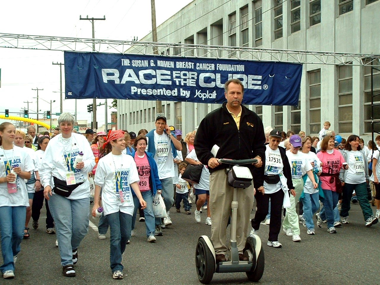 "Riding a Segway in the annual ""Race for the Cure"""