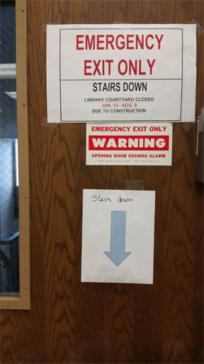 photograph of handwritten sign for stairs