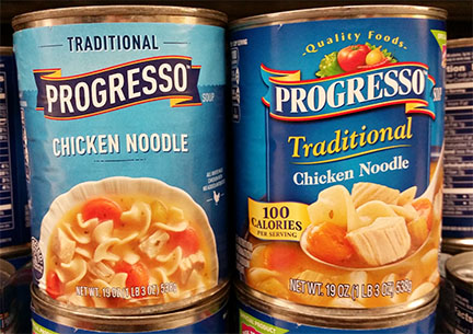 photograph of two cans of chicken noodle soup