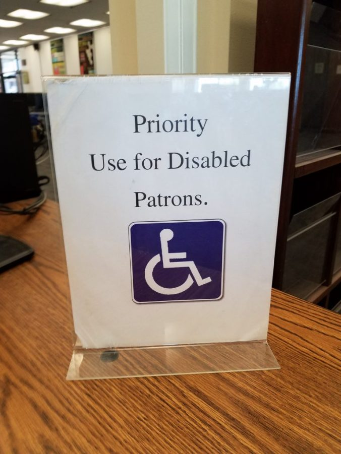 sign that reads priority use for disabled patrons