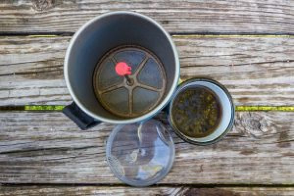 coffee outdoors camp on wood surface msr gear