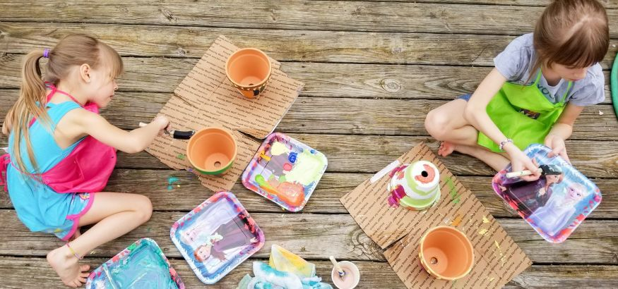 girls painting ceramic terra pots arts and crafts homeschool activity for kids spring