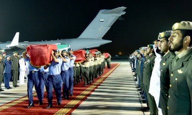 Emirati soldiers carry coffins of UAE soldiers killed in the deadly missile attack. Photograph: Emirates News Agency/EPA