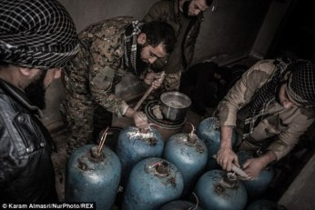 "Aleppo: ""Rebels"" fill gas canisters with nails and high explosive to be fired from the Hell Cannon"