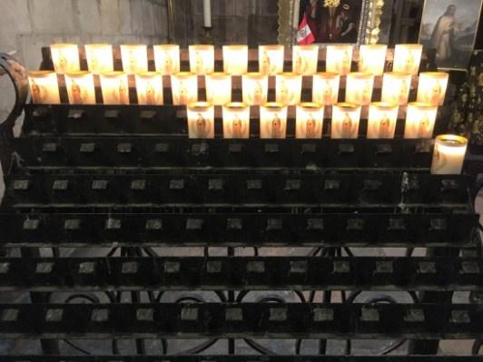 notre-dame-candles-in-stand