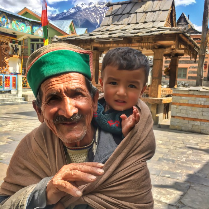 a kid and his grandfather in Kamru Fort sangla valley, India