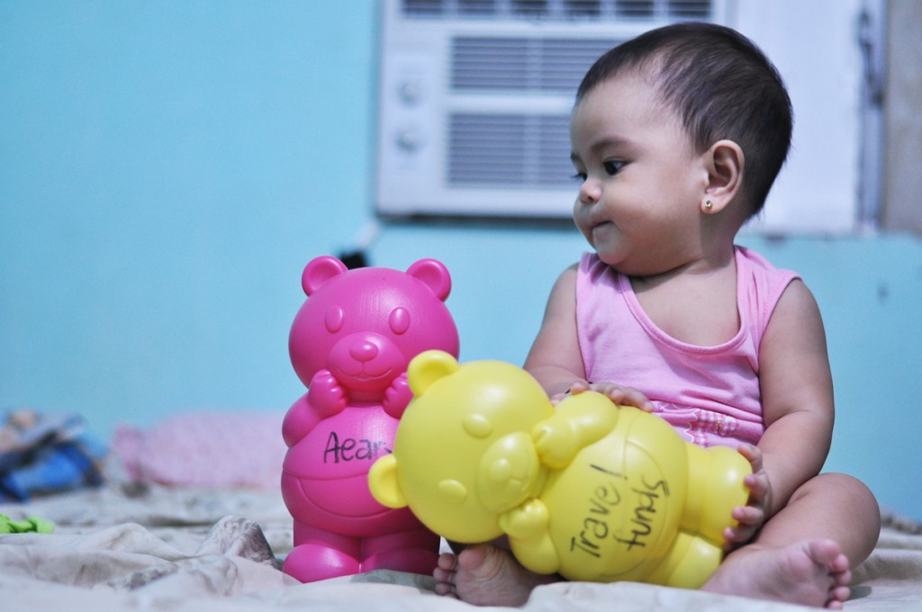 Baby Aeary staring at her Baby Bear Bank which could also qualify as her Doppelganger.