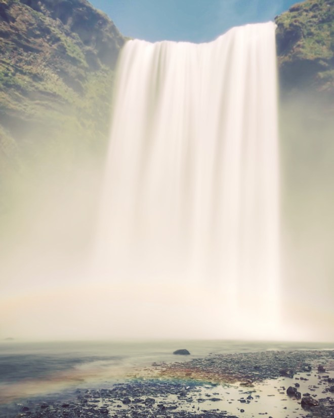 Rainbows at Skógafoss long exposure - 38 photos to visit iceland from the wandering darlings
