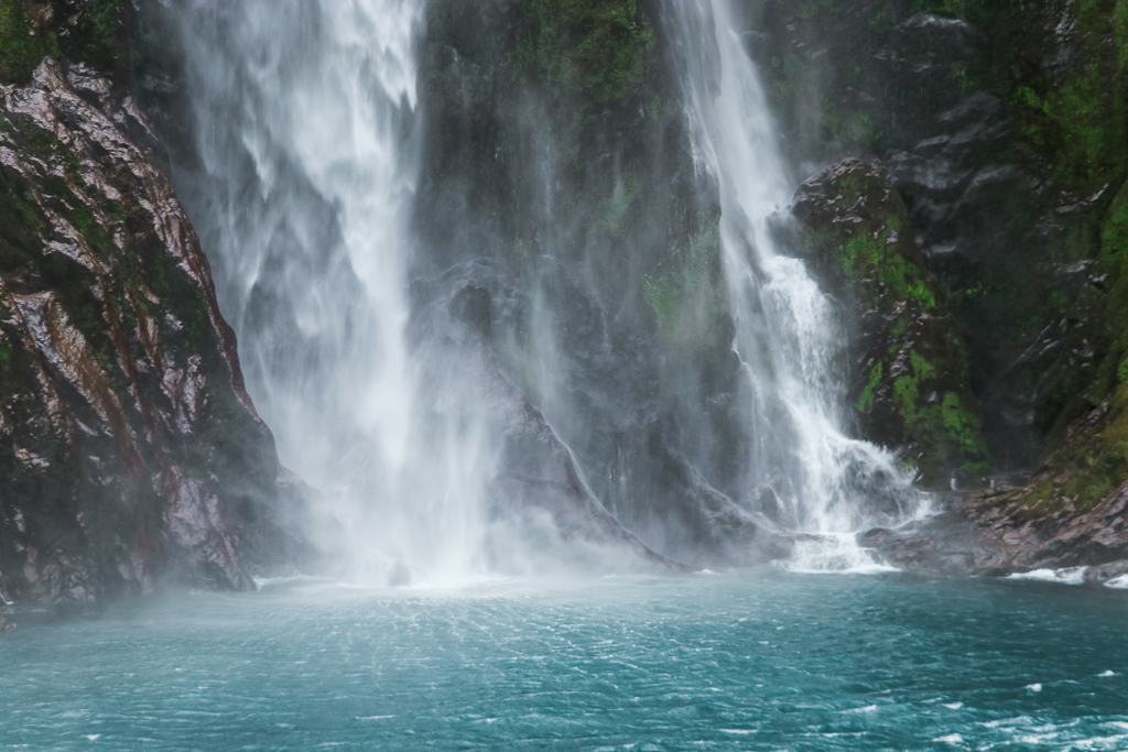 The boat goes very close to the waterfall in Milford Sound.