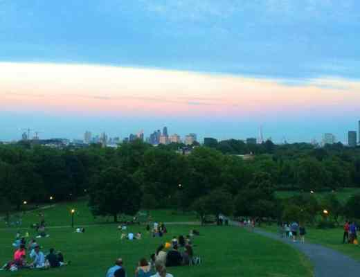 picnic in a london park with a city view