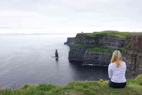 blonde girl cliffs of moher west coast ireland
