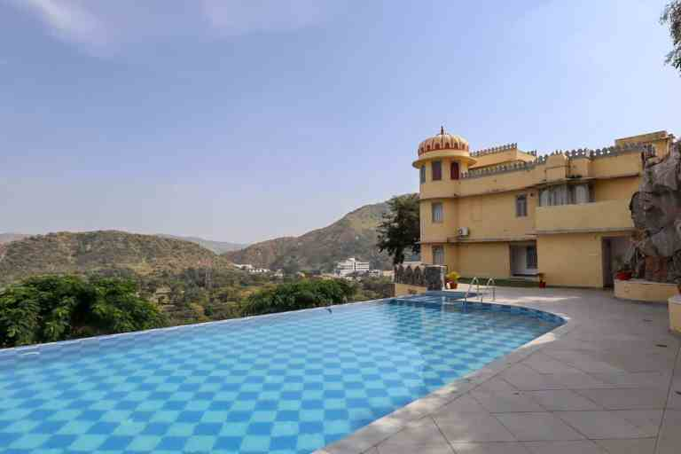 swimming pool and mountains at Shahpura Kumbhal | best places to visit in India