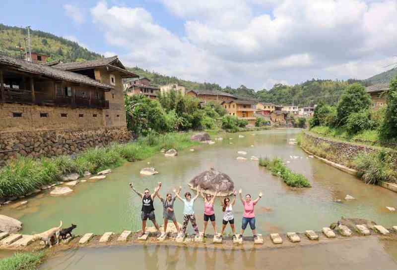 people standing in river in china | backpacking checklist