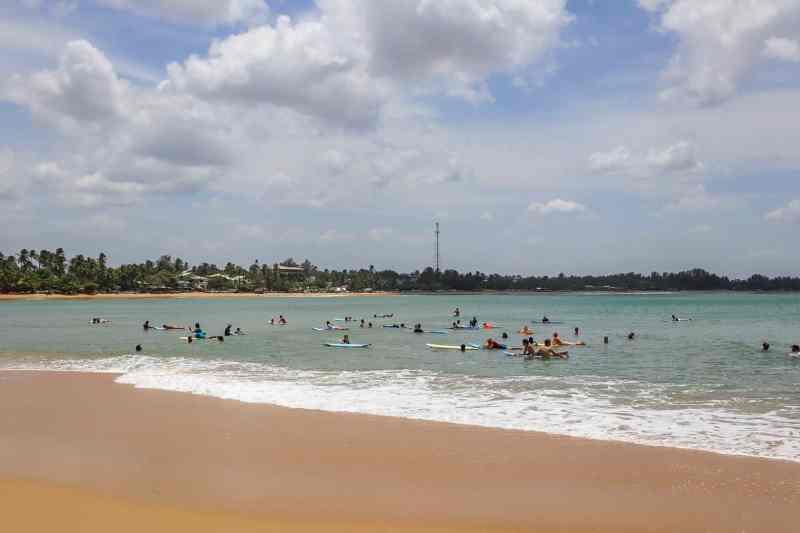 Things to do in Arugam Bay, surfers in the ocean in Arugam Bay