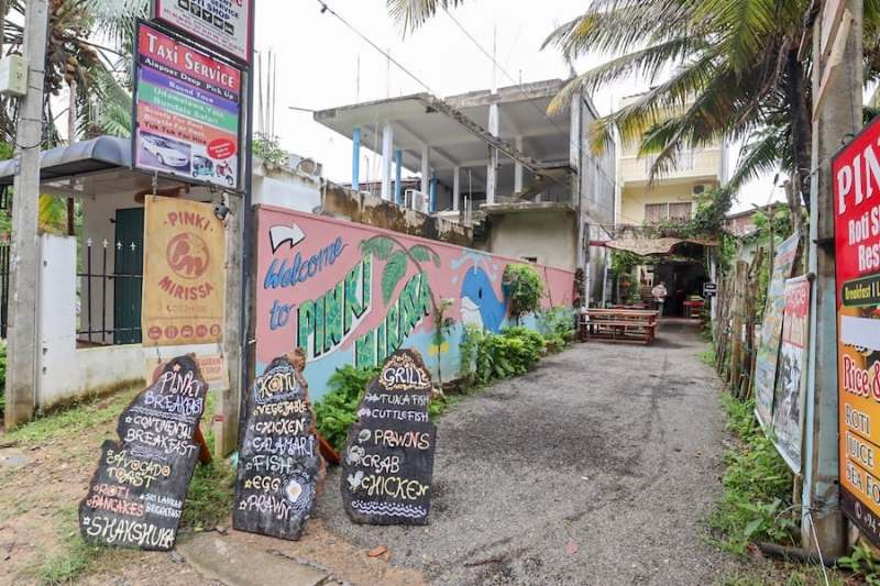 outside menu and street art of Pinki Cafe in Mirissa | best cafes in Mirissa