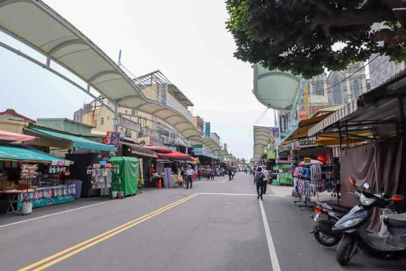 Kaohsiung to Cijin Island, Cijin Island street with shops and bike hire