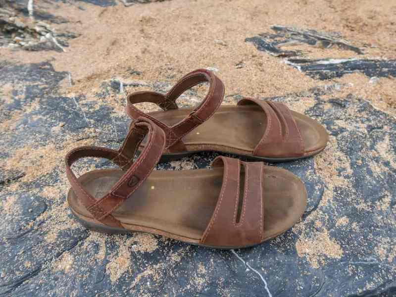 Keen Brown Sandals on rock with sand