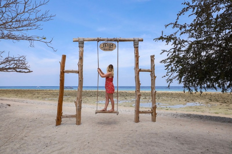 Ellie in Red Playsuit on Gili T swing | things to do in Gili T