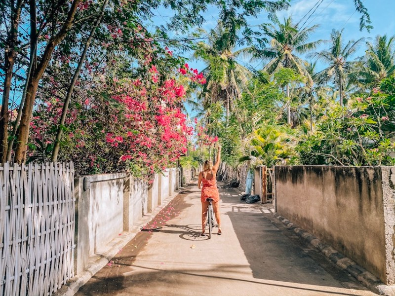Gili Islands, ellie quinn on bike in gili t with flowers