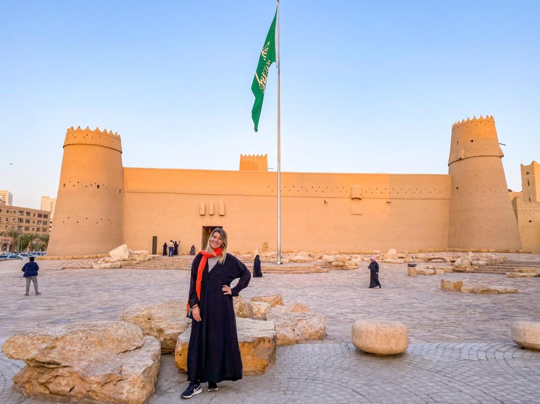 what to wear in Saudi Arabia as a woman, ellie quinn at masmak fort in Riyadh in an abaya