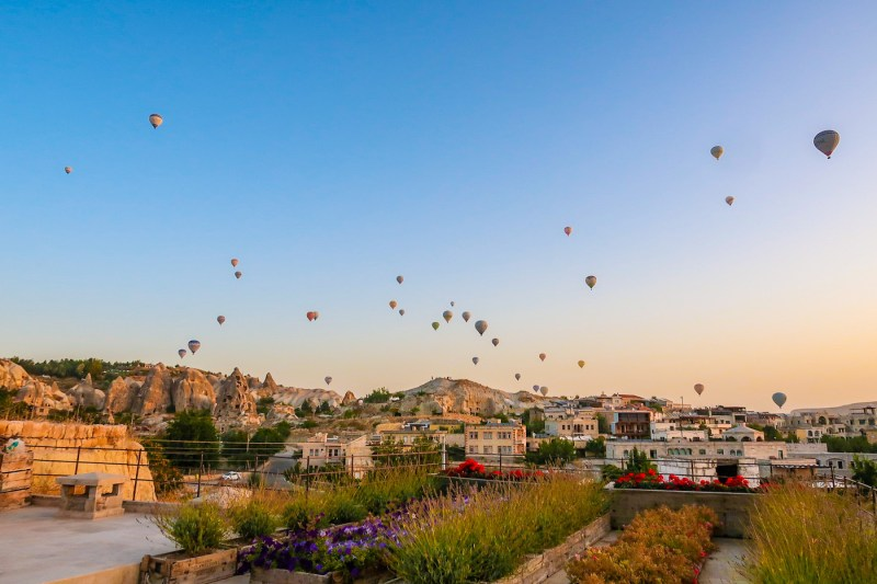 best time to visit Cappadocia, sunrise blue sky and hot air balloons