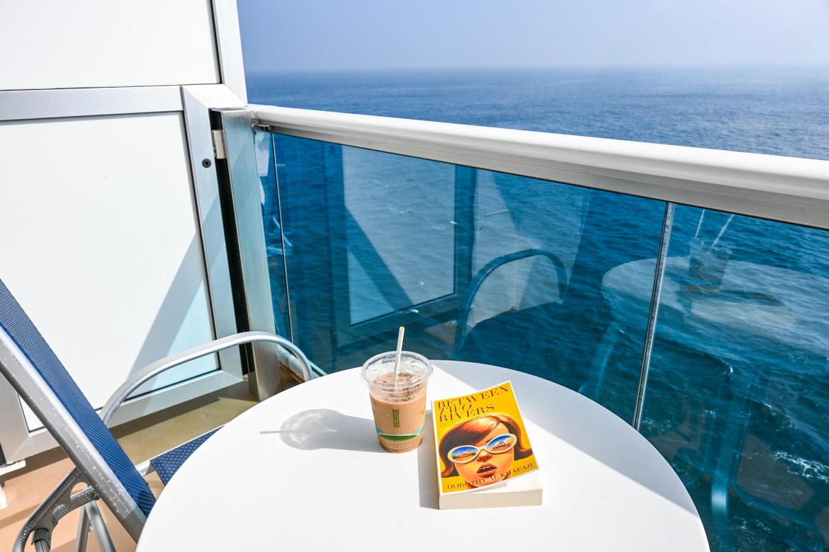 Princess Cruises from Southampton, ice coffee and book on balcony