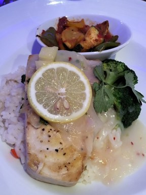 Grilled swordfish with coconut rice, fresh pineapple and lemon, red pepper sauce and ratatoullie.