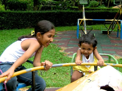 Kids playing on the roundabout, Gampaha Kiddies Park