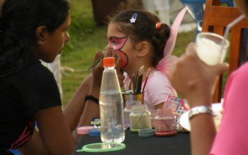 Little girls get their faces painted at birthday parties