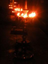 An arrangement of brass oil lamps