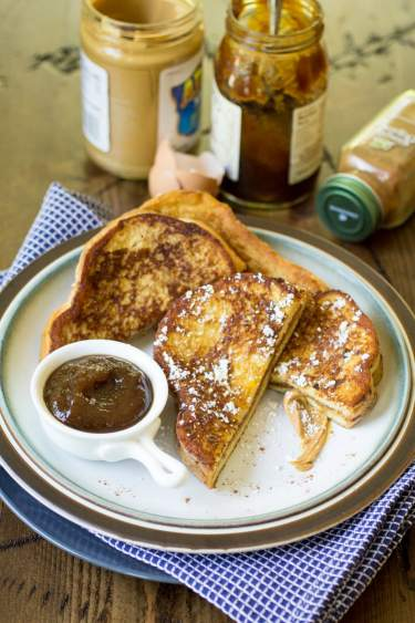 Peanut Butter and Jelly French Toast is delicious and easy: make a Peanut Butter and Jelly sandwich, dip it in batter, and fry as french toast. Perfection!