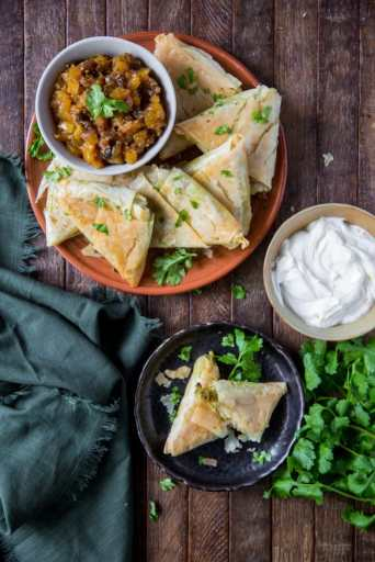 This Baked Samosa Beef recipe is a delicious combination of lean beef, potatoes, peas, sweet yellow onions and spices wrapped up in a golden pastry shell for a savory, crunchy appetizer.