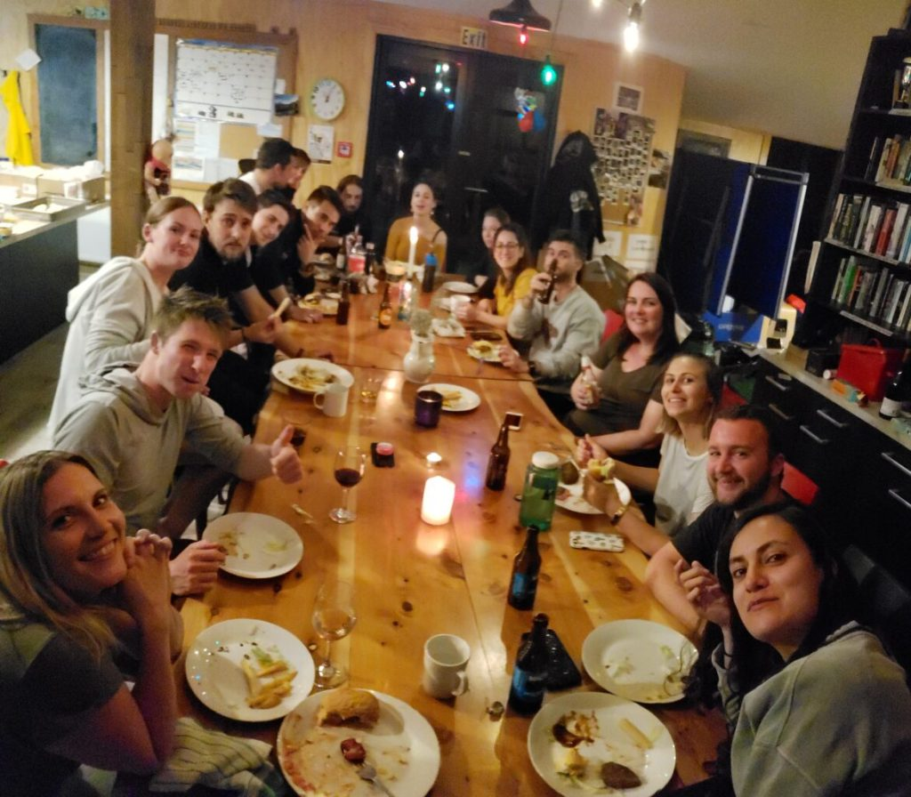 Family dinner at Bedrock - staff communal house in Milford Sound Lodge