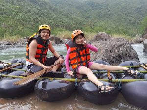 My brother and his 10-year-old daughter trying River Rafting in Real Quezon