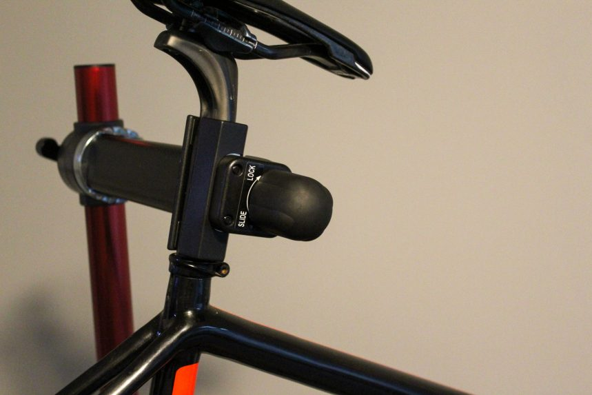 Feedback Sports Classic Bike Repair Stand's Slide Lock clamp jaw in action.
