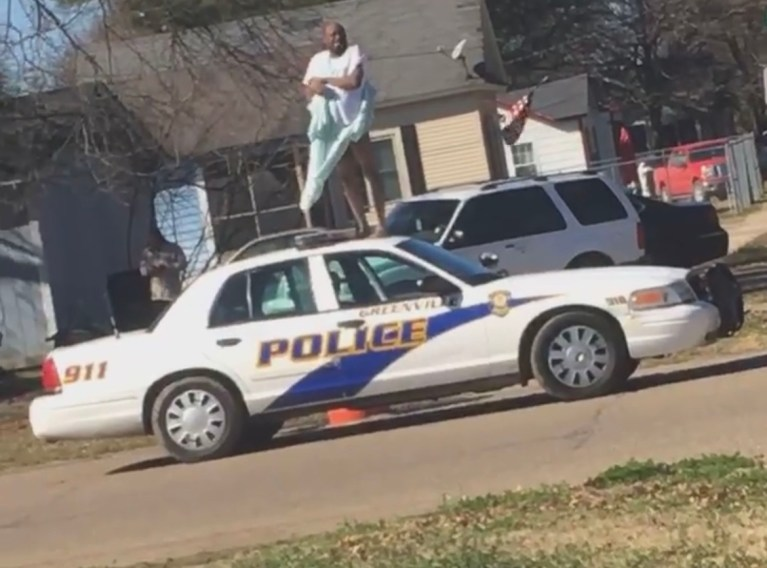 Breaking News: Man In Hospital Gown Steals Greenville Police Car And Dances On Top Of The Cruiser.