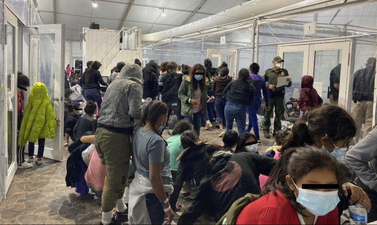 Migrants held in overcrowded Texas facility.
