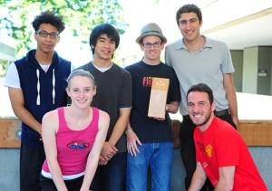 Alvin Loong, Alex Clark, Deric Gruen, Mackenzie Williamson and Zach Boucher show off sustainability's new award.