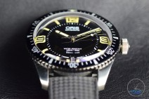 Oris Divers Sixty-Five closeup sitting on black leather [01 733 7707 4064-07 4 20 18]