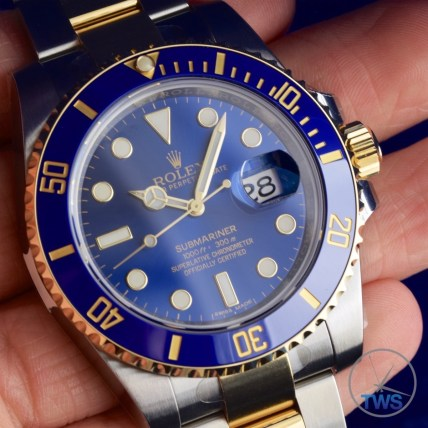 Hand held Rolex Submariner Date [116613LB] close up