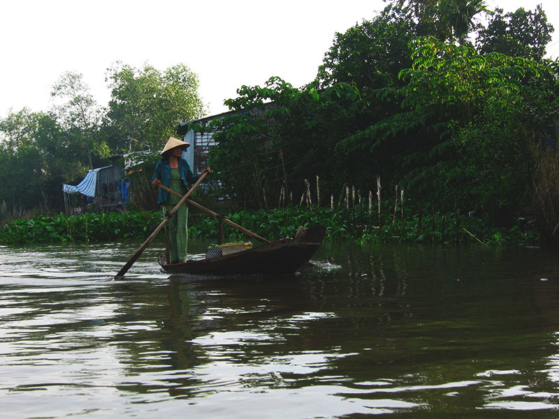 vietnam mekong delta people rowboat