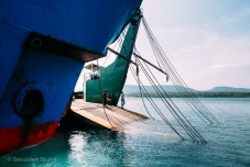 The slow moving ferry between Bali and Java prepares to load vehicles and passengers. Indonesia, June 2014.