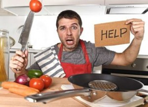 terrified-man-at-kitchen-wearing-cook-apron-showing-help-sign-looking-desperate45948668-123RF