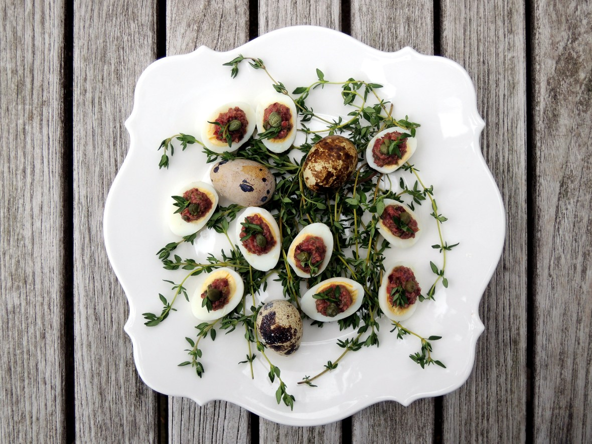 Appetizers, eggs, quail eggs with olive puree 1