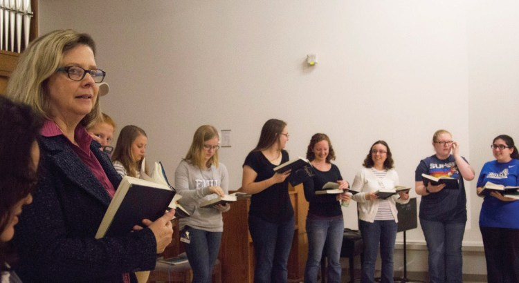 Dr. Huxman participates in a hymn sing
